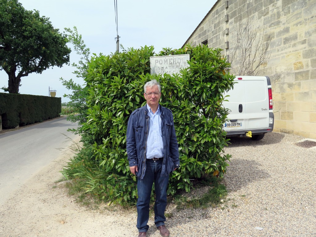 Denis Durantou, owner of l'Eglise-Clinet, outside his property. The Château's name is barely discernable on the faded sign behind him.