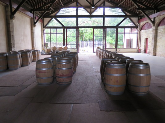 Empty oak barrels in the chai at Château Batailley.