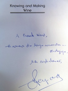 "Emile Peynaud presents a copy of his classic ""Knowing and Making Wine"" to Frank Ward, following a ""long conversation about oenology"" in his home in Talence."